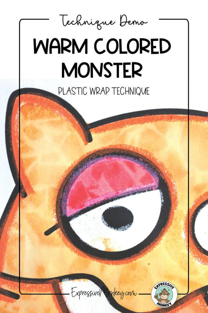 """A close-up of a cartoon monster showing the eye and ear. The shapes of the orange and red monster were outlined with oil pastel before being painted with watercolor. Plastic wrap was laid on the wet watercolor to create a texture. The text says, """"Technique Demo - Warm-Colored Monster - Plastic Wrap Technique""""."""